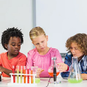 Children experimenting with test tubes.